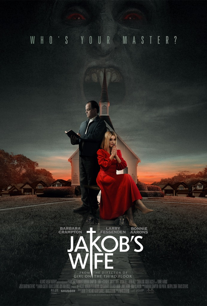 The film poster showing Jakob (Larry Fessenden) reading in a bible and Anne (Barbara Crampton) praying next to him in a startling red dress. Behind them is a chruch, and in the sky we can see a half-transparent face of a vampire.