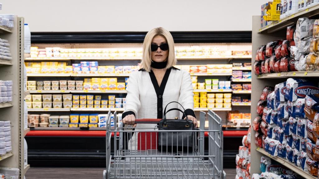 Anne (Barbara Crampton) going shopping in style.