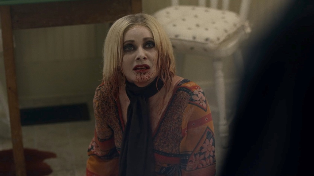 Anne (Barbara Crampton) with her chin full of blood.