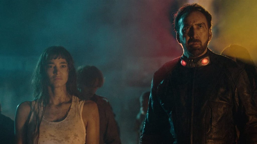 Bernice (Sofia Boutella) standing next to the Hero (Nicolas Cage).