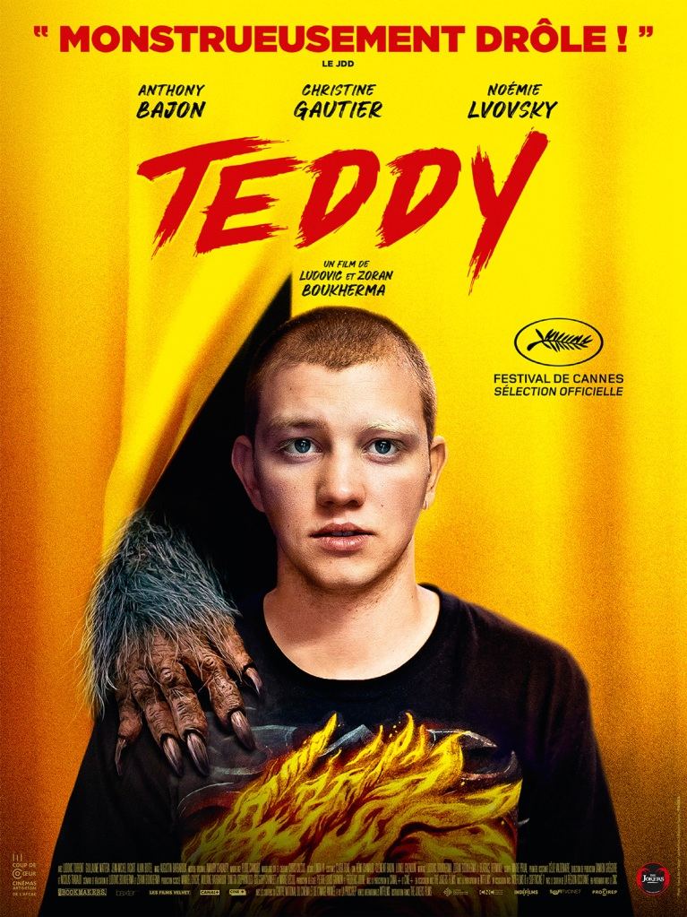 The film poster showing Teddy (Anthony Bajon) standing in front of a yellow curtain. There is a werewolf paw pushing through the curtain and laying on his shoulder.