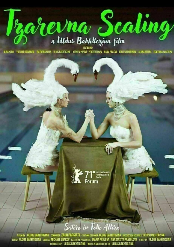 The film poster showing two women wearing elaborate swan hats sitting at a table next to a swimming pool where they armwrestle.