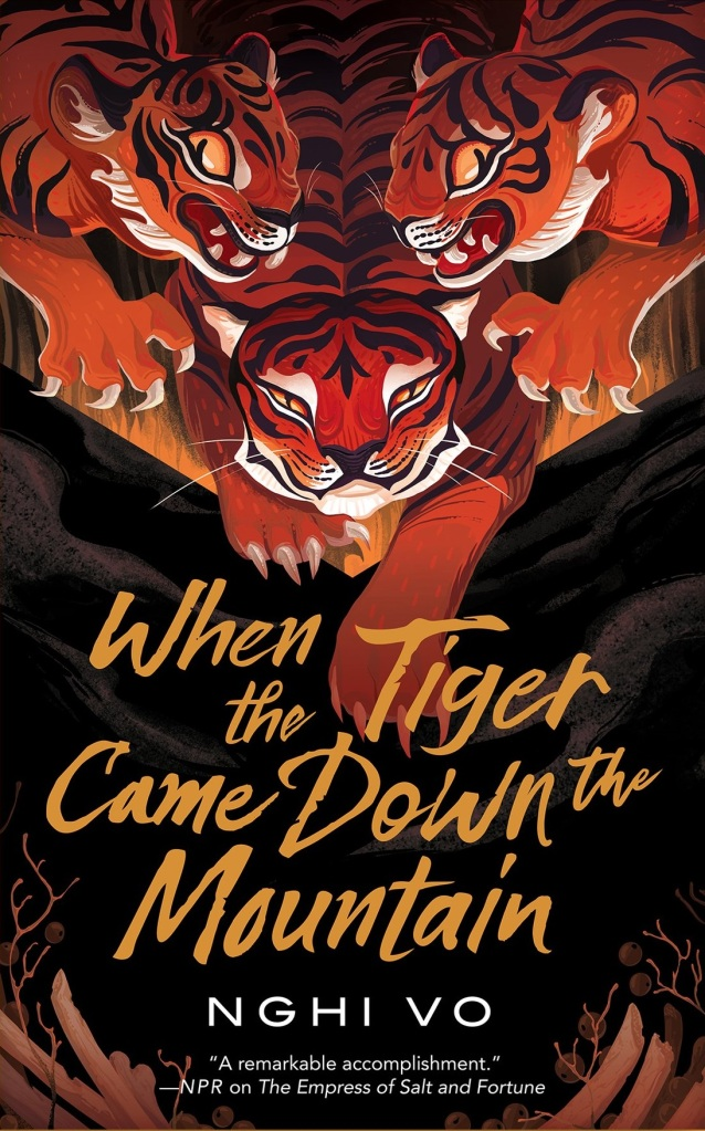 The book cover showing three painted tigers walking down towards a hill or mountain.